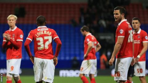Charlton Athletic players look dejected following relegation