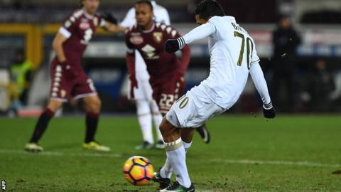 Carlos Bacca equalises for AC Milan from the penalty spot against Torino