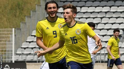 Billy Gilmour celebrates his goal with Fraser Hornby