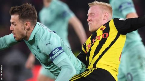 Will Hughes (right) tackles Wales' Aaron Ramsey during Watford's Premier League loss to Arsenal on Monday