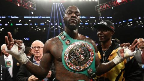 Deontay Wilder celebrates after beating Luis Ortiz in March