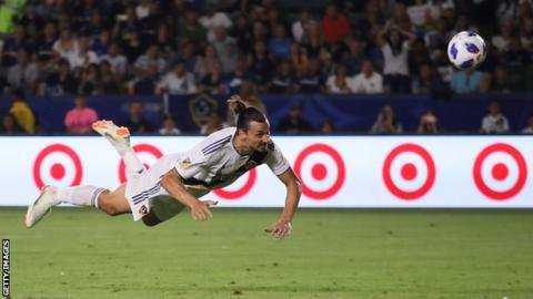 Zlatan Ibrahimovic scores his second goal with a diving header