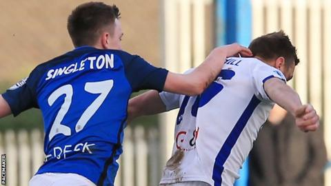 Glenavon's James Singleton was sent off for pulling back Ian Parkhill of Coleraine