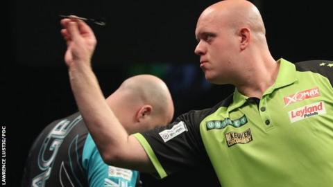 Michael van Gerwen throws a dart