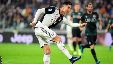 Ronaldo smashes 701st goal as Juventus reach top spot in Serie A