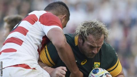 South Africa prop Jannie du Plessis is tackled by Japan's back row Hendrik Tui
