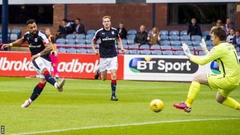 Kane Hemmings scores for Dundee against Dumbarton