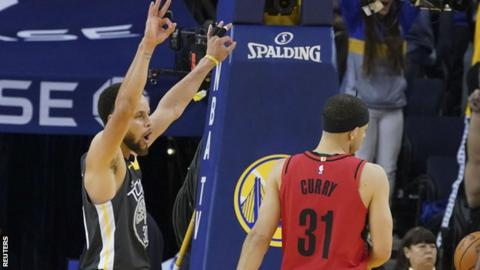 550f971a140b Stephen Curry shoots a three-pointer in front of younger brother and Portland  Trail Blazers guard Seth