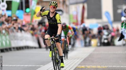 Australia's Cameron Meyer raises his hand to celebrate victory on stage two of the 2018 Tour of Britain