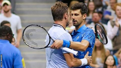 Novak Djokovic and Stan Wawrinka embrace at the net after the former's withdrawal injured
