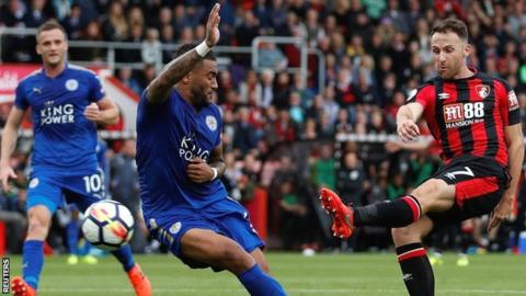 Danny Simpson (left) appears to block Marc Albrighton's shot with his hand