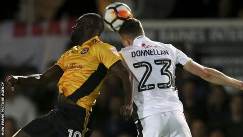 League Two Newport claimed the scalp of League One Walsall in the FA Cup first round