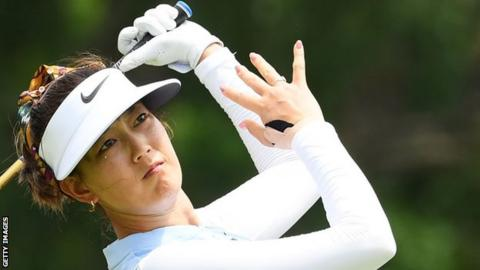 Michelle Wie playing with her right hand heavily strapped during a tournament in February
