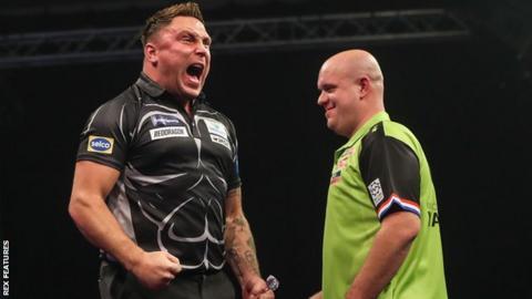 Gerwyn Price celebrates as he beats Michael van Gerwen