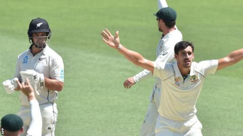 Mitchell Starc successfully appeals for the wicket of Colin de Grandhomme