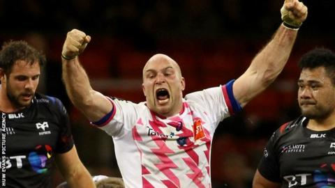 Stade Francais flanker Antoine Burban celebrates his team's win over Ospreys in Cardiff
