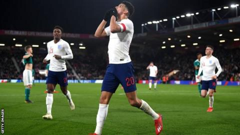 Dominic Solanke celebrates scoring for England U21s