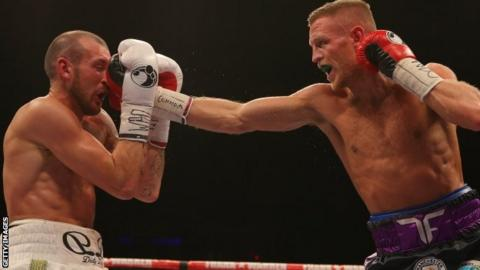 Derry Matthews is punched in the face by Terry Flanagan
