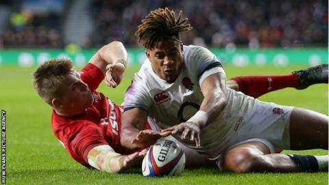 Gareth Anscombe (left) appears to touch the ball down despite pressure from Anthony Watson
