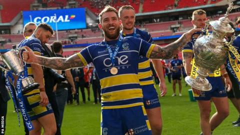 Warrington's Daryl Clark celebrated winning both the Challenge Cup and the Lance Todd Trophy