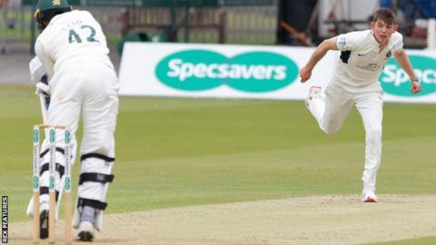 Ethan Bamber bowling against Leicestershire
