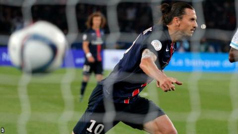 Zlatan Ibrahimovic celebrates scoring a penalty for Paris St-Germain