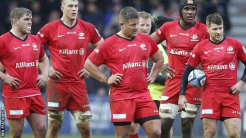 Saracens players as Quins run in another try in their 41-14 victory against the relegated champions