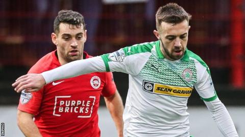 Larne's Mark Randall in action with Conor McMenamin of Cliftonville