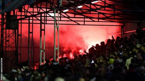 The red flare at the Hyde United-MK Dons went off in the home end