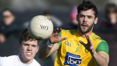 Donegal's Odhran MacNiallais beats Kevin Feely to win possession in Ballyshannon