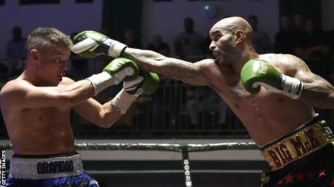 Leon McKenzie (right) fights John McCallum