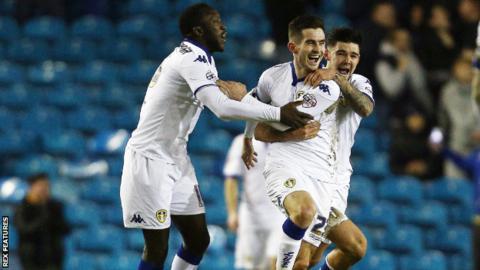 Lewis Cook celebrates scoring for Leeds against Fulham