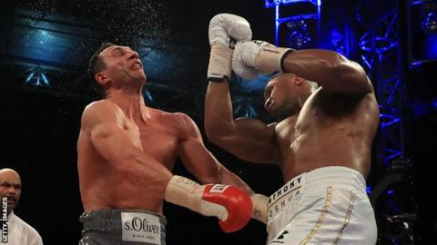 Anthony Joshua (right) lands a punch on Wladimir Klitschko