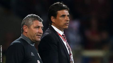 Osian Roberts and Chris Coleman watch Wales against Moldova in September, 2016