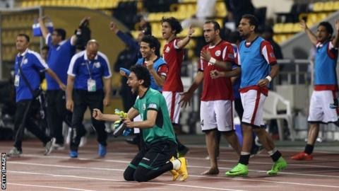 Yemeni players celebrate after winning their 2019 Asian Cup qualifier against Tajikistan in Doha