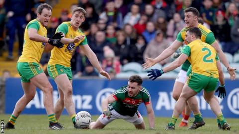 Mayo's David Drake is surrounding by four Donegal players at Ballybofey