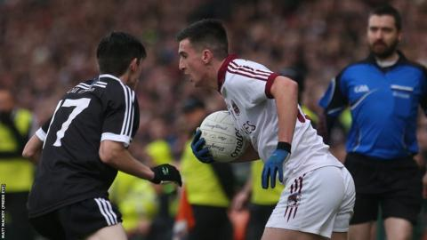 Kilcoo's Eugene Branagan attempts to block the progress of Slaughtneil opponent Meehaul McGrath during the Ulster Club decider