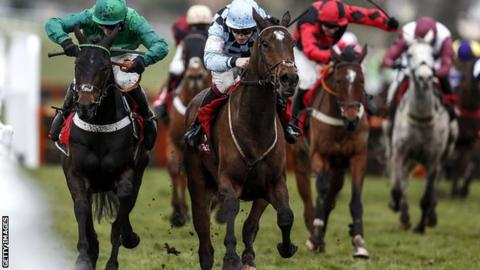 Jamie Bargary in light blue and black, on Mr Antolini (second from right), got close to Daryl Jacob in green on Call Me Lord (left)