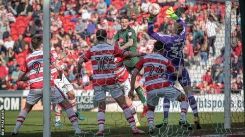 Sonny Bradley heads Plymouth's winner against Doncaster