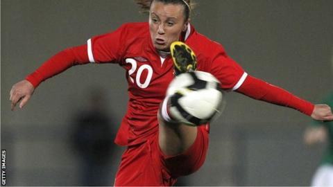 Natasha Harding controls a high ball during a Wales match