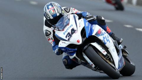 Alastair Seeley on the way to winning one of the Superbike races on a Tyco Suzuki at the 2012 North West 200