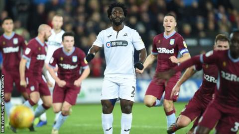 Swansea striker Wilfried Bony watches his penalty saved against Aston Villa
