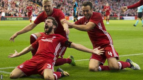 Aberdeen's Graeme Shinnie (left) celebrates against Apollon Limassol