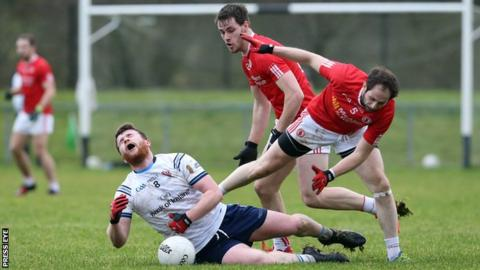 Tyrone's Ronan McNabb battles with Ulster University's Ruairi McGlone