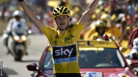 Chris Froome crosses the finish line first after winning stage 10 of the 2015 Tour de France