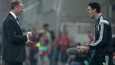 NI boss Michael O'Neill and Kyle Lafferty celebrate the qualifier win over Greece in Athens
