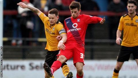Mark Byrne of Newport battles away with York's Kenny McEvoy