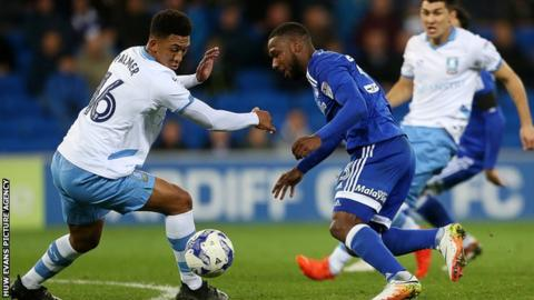 Junior Hoilett of Cardiff City is challenged by Sheffield Wednesday's Liam Palmer