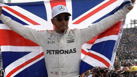 Lewis Hamilton celebrates winning the 2017 title