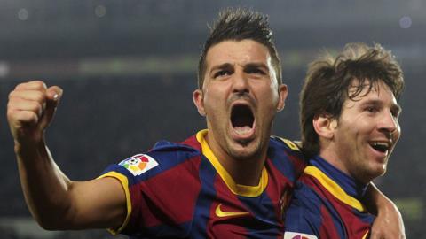 David Villa celebrates a goal with Lionel Messi